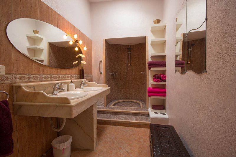 en suite with his n hers basins,walk in shower was the original bread oven