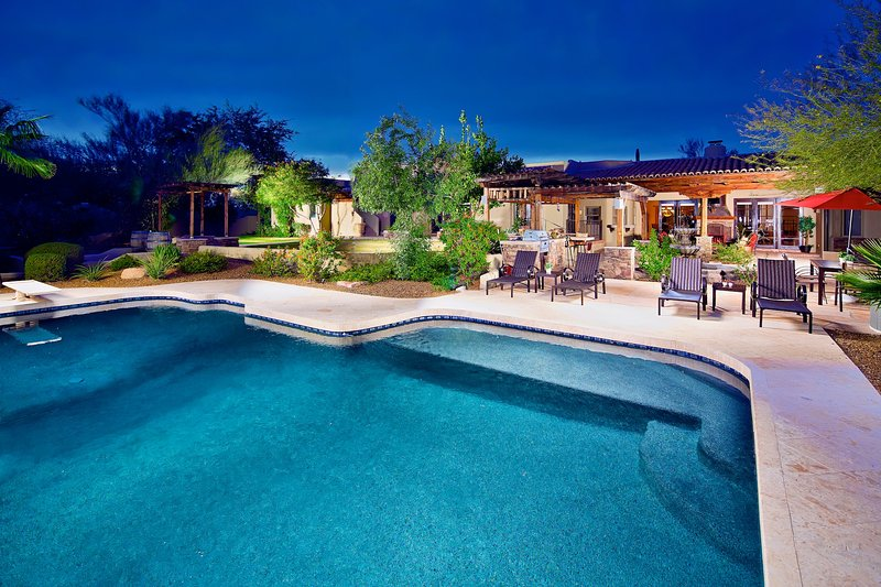 Resort style grounds with relaxing heated pool.