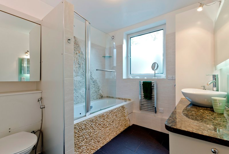 Master bathroom with jetted tub and overhead shower