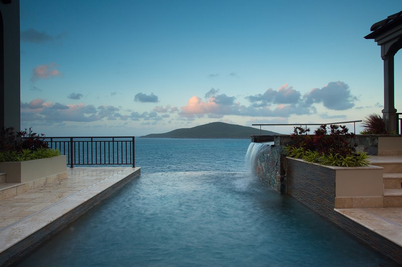 Hot tub that waterfalls into the infinity edge pool.