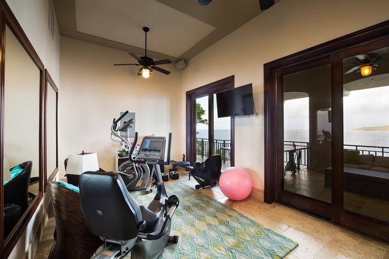 The gym features an elliptical, bike and rowing machine.