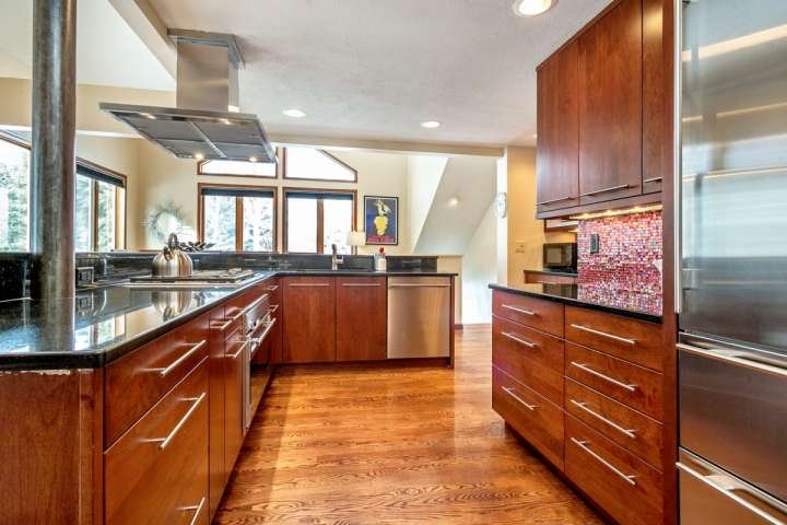 Fully equipped kitchen includes Wolf 4 burner gas stove and hood system and large Subzero refrigerator.