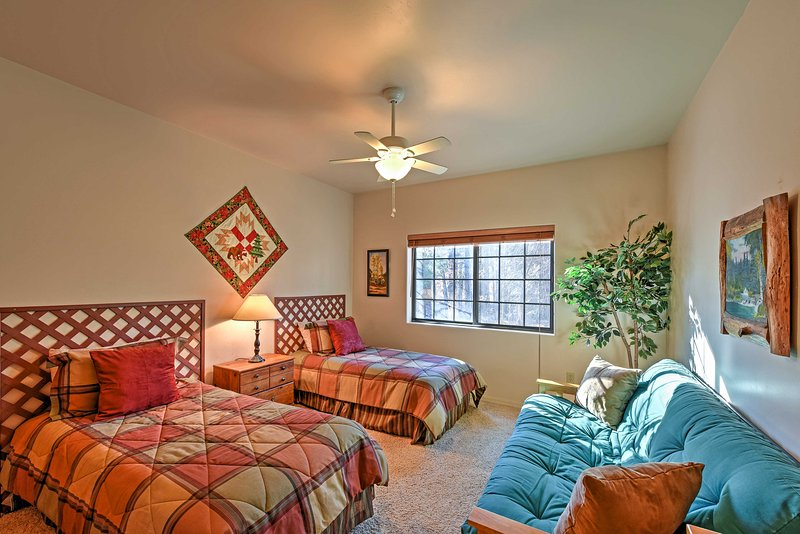 Bedroom 3 boasts 2 twin beds and a futon.