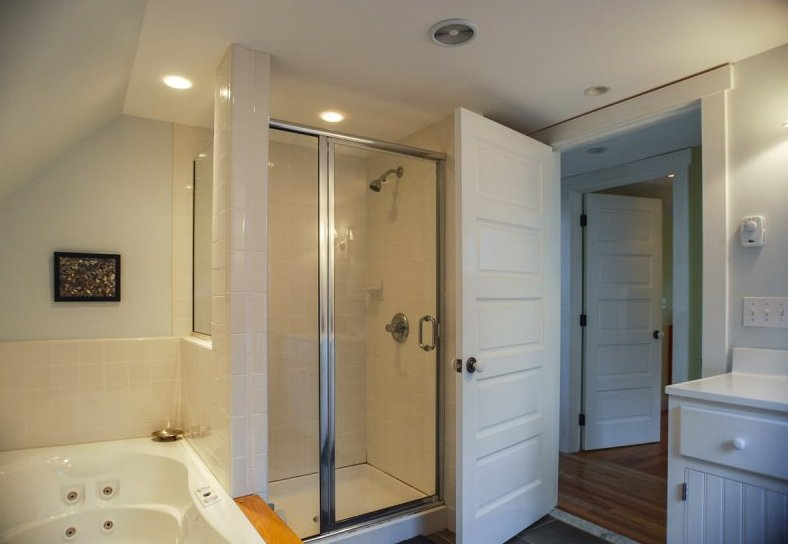 Upper floor bathroom with large tub and shower