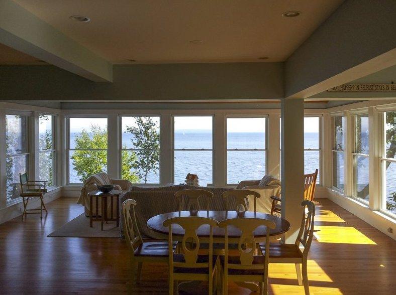 As you enter open concept ocean views abound