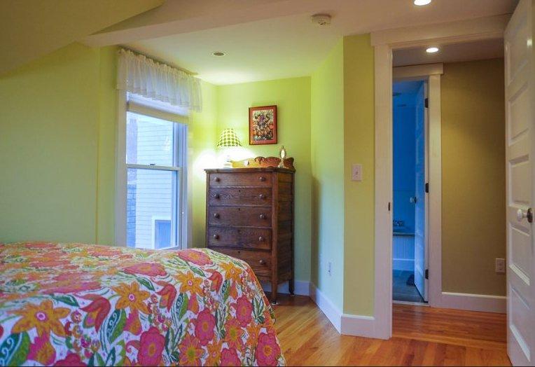 Queen bedroom facing bathroom