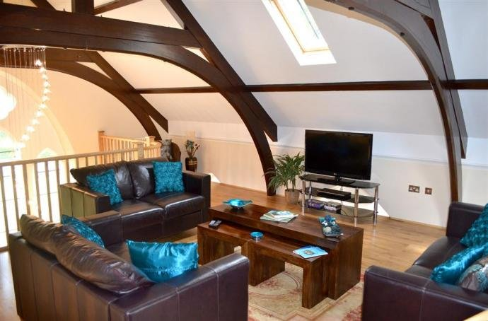 The lounge featuring the original chapel beams.
