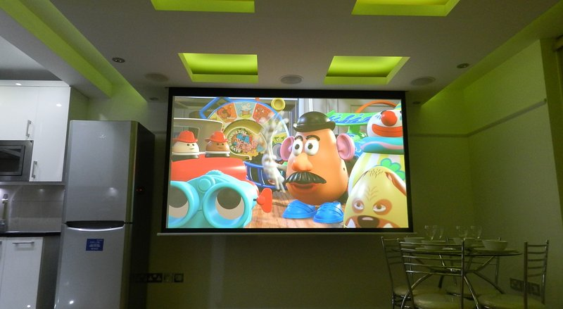 Reception Room - Home cinema with projector & surround-sound, widescreen TV, dining table & 4 chairs