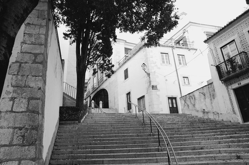Maze of narrow streets and stairs of Alfama at the foot of the building ... typical!