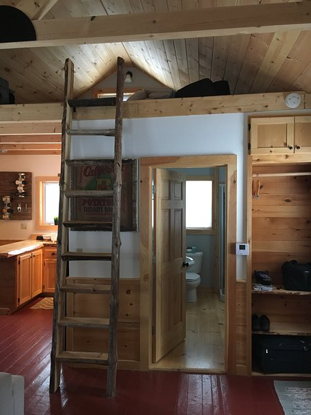 Ladder to loft space with two twin beds.