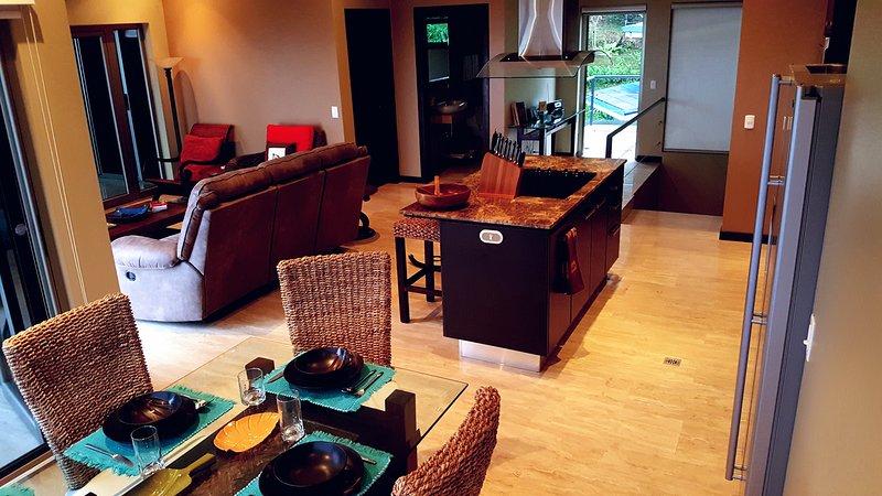 Upper level including: dining room, kitchen, living room, master bedroom and half-bath.