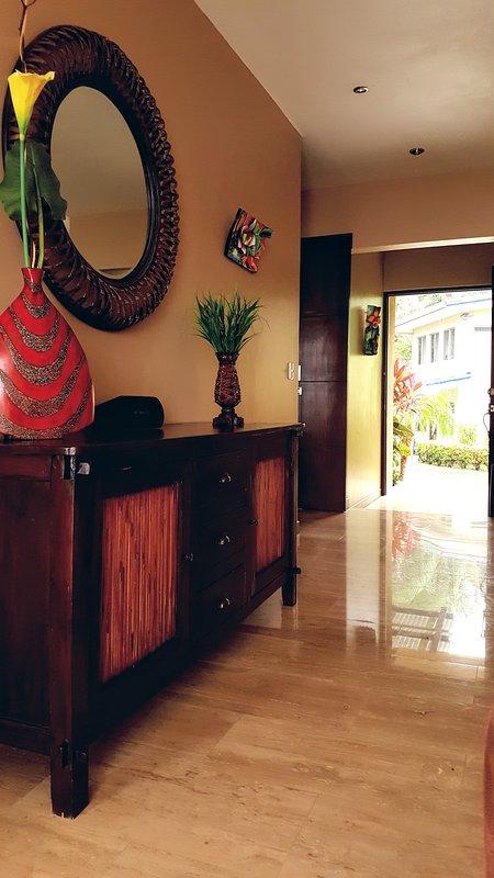 Lower level living room and front door.