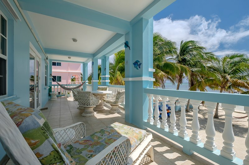 Can you beat the view?  Gorgeous second floor balcony with hammock, lounge chair and dining area