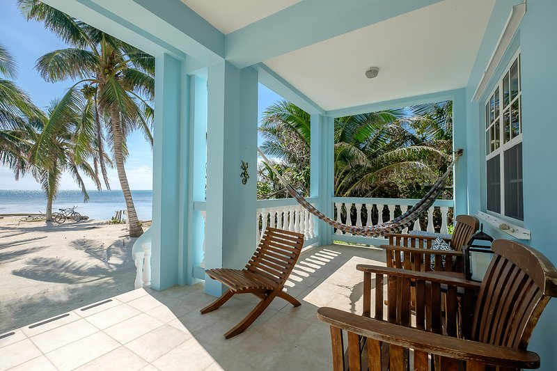 Beautiful porch with local hardwood furniture leading right to beach!