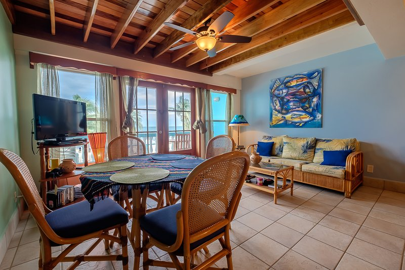 Gorgeous living and dining areas with high wood beamed ceilings! Charming warm colors throughout!