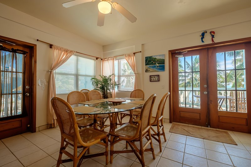 Bright dining area with beautiful views and french doors leading to second floor balcony!
