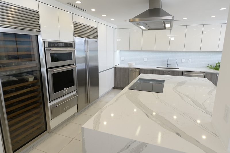 Fantastic kitchen area with Cambria quartz island and top of the line appliances