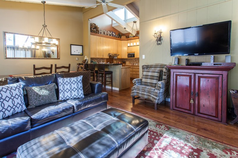 Great Room open to the dining area, bar and kitchen. Cozy fireplace, 50' TV, queen sleeper sofa