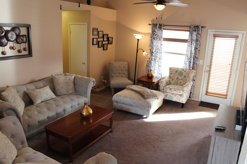 Living area and exit to covered patio.