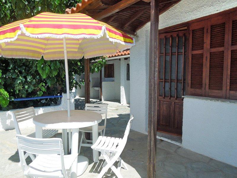 Villa CAMELIA. O acesso à sala no piso térreo da varanda pamnoramica.