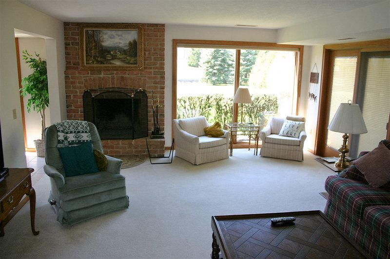 Living room with fireplace and water view