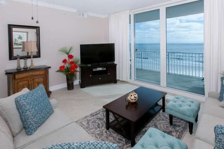 Living room with TV/DVD and sliding glass door to Gulf-front balcony