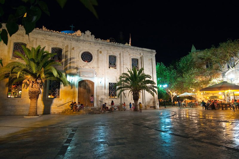 Night view of Agios Titos church. All major sites of the city are within walking distance