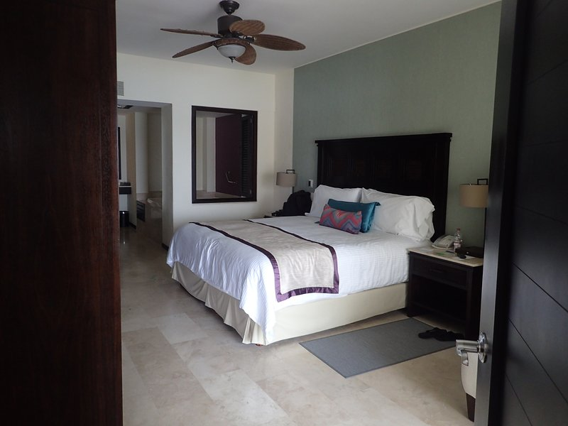 Master bedroom with King size bed, huge jet tub, makeup sitting area, full bath and balcony.