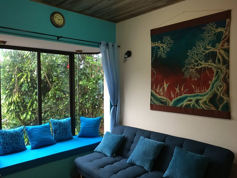 This is the sitting area and spacious window seat and sofa-bed that sleeps 2.