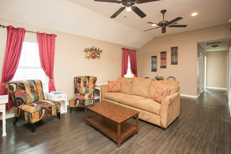 Living area featuring 49' hdtv and sleeper sofa.