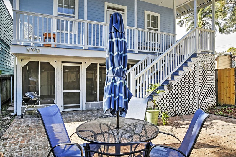 A screened-in front porch with a swing, as well as a patio area in the backyard, are perfect spots to relax and enjoy a refreshing beverage.