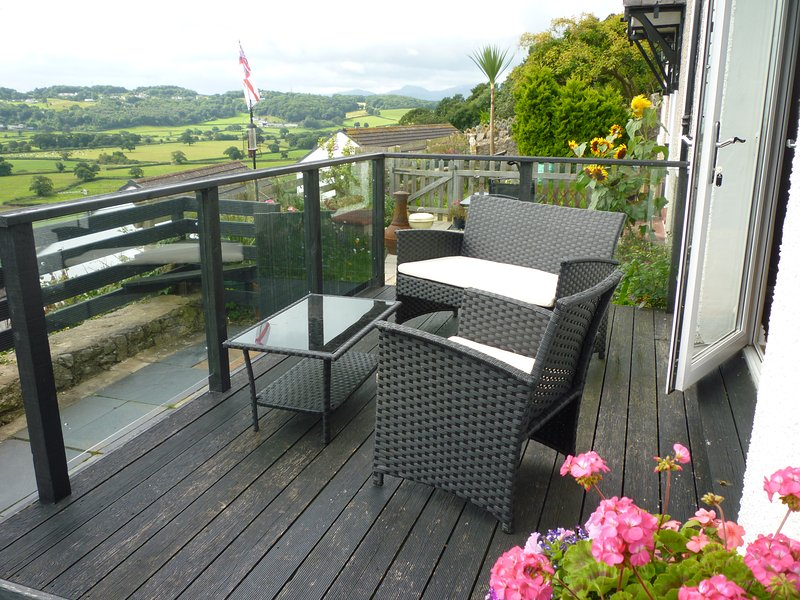 Far reaching sea and countryside views from the decking.