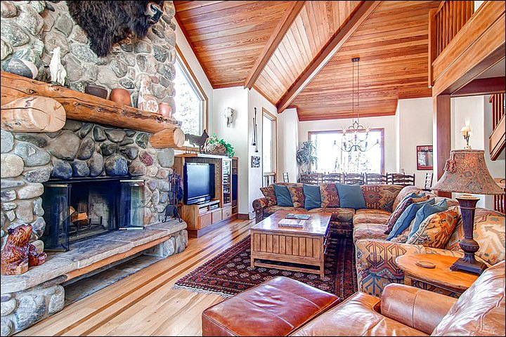 Fine Furnishings and Warming Cobblestone Fireplace in the Great Room