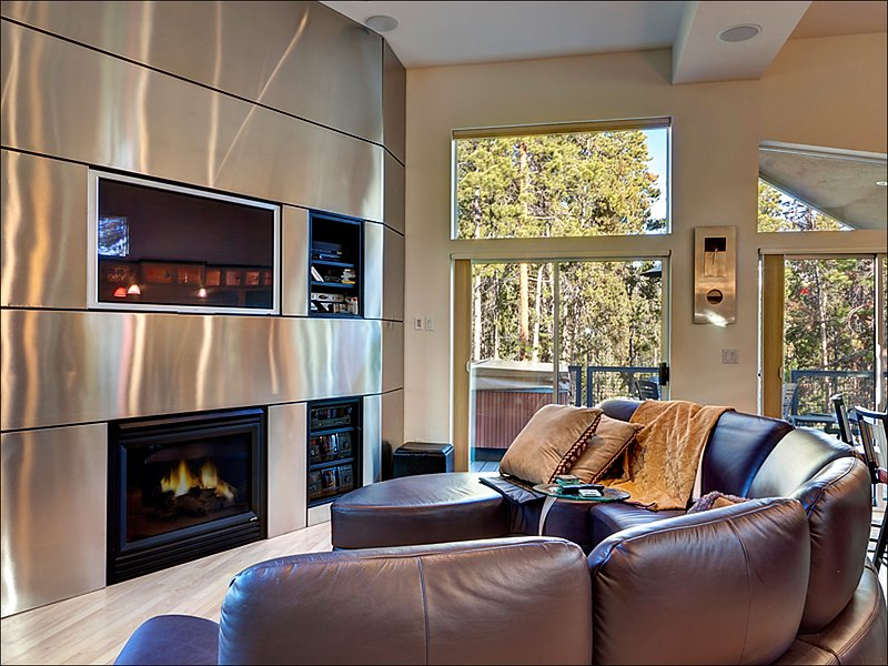 Living Room Boasts a Gas Fireplace and Large LCD TV