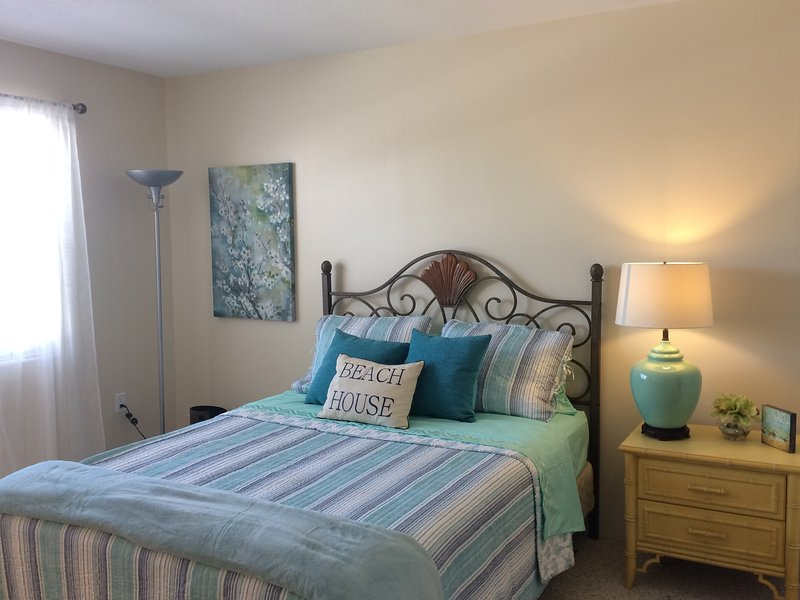 Comfortable queen size master bedroom with new linens