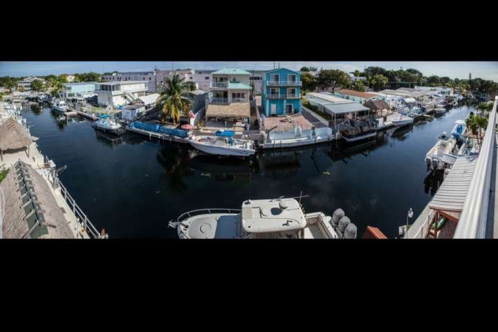 Panoramic view from the back of the house on the ceiling terrace - Private dock with direct canal access