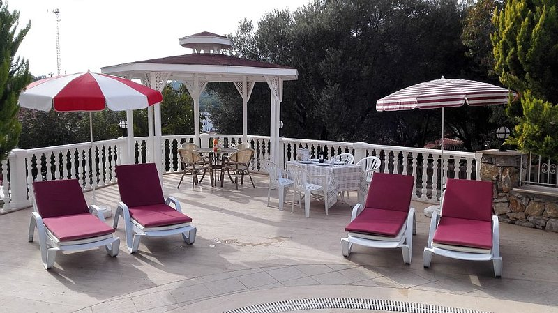 Lowly place to sit and relax and thake o glass of wine or raki and Efes beer.