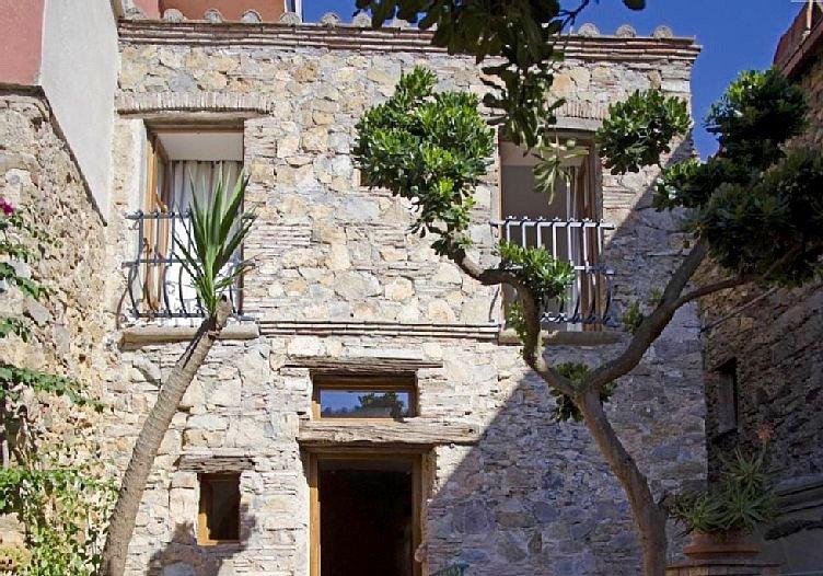 Casa con giardino nel centro storico, holiday rental in Gualdo a Capoliveri
