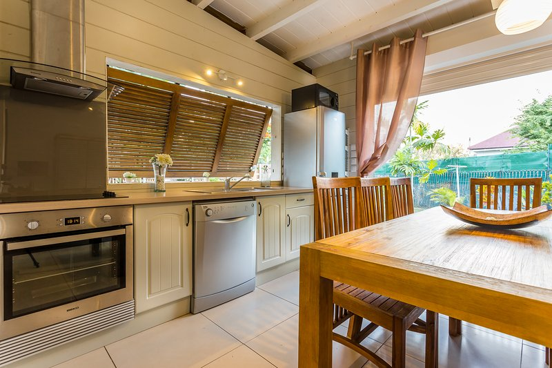Fully equipped kitchen opening onto the garden