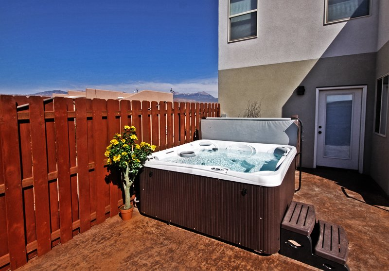 Private Hot Tub | Entrance to Main Floor #1 Bedroom