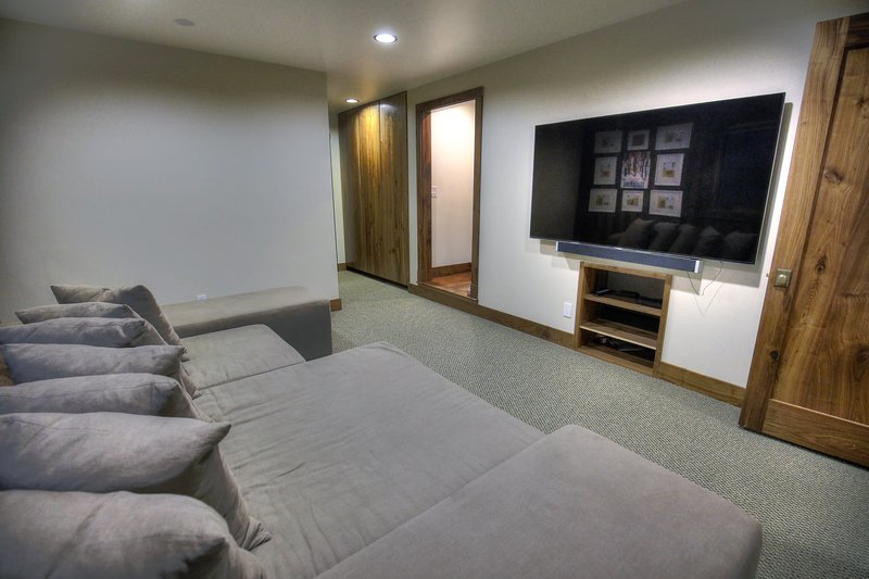 Media room with 70 inch HD tv with Direct Satellite TV and oversized superplush lounge sofa