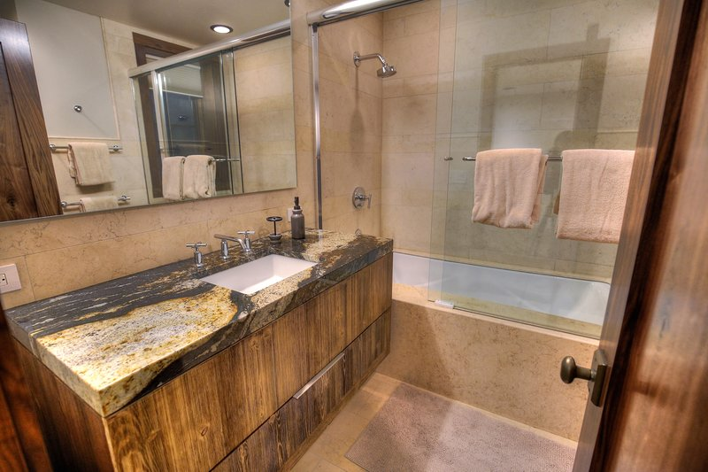 2nd Master (basement level) large soaking tub + shower, single vanity sink.