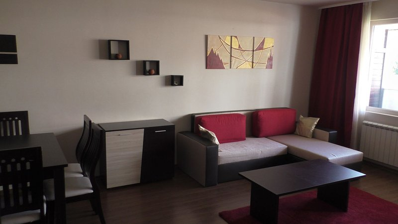 Living room with brand new sofabed #1 (sleeps 2 adults)