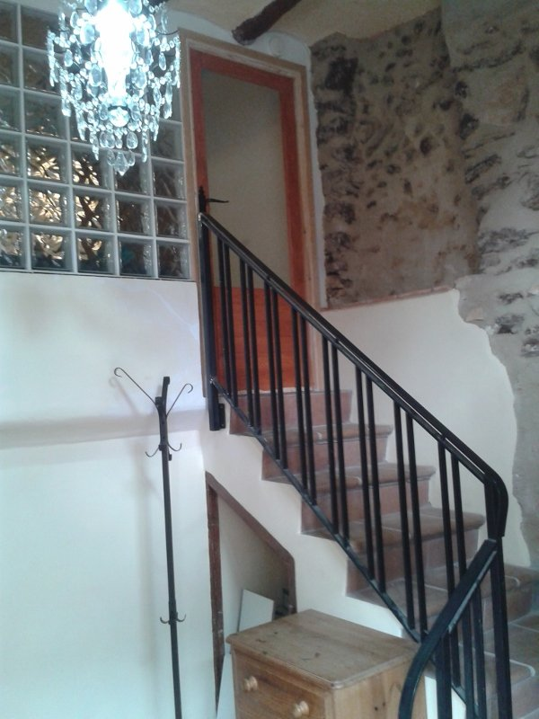 Stairs to the kitchen, leading from the basement with masses of storage for bikes and other kit