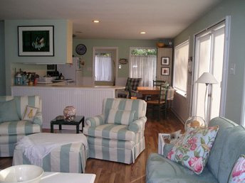Sunny Living room --looking towards kitchen --French Doors lead out to full west-facing deck