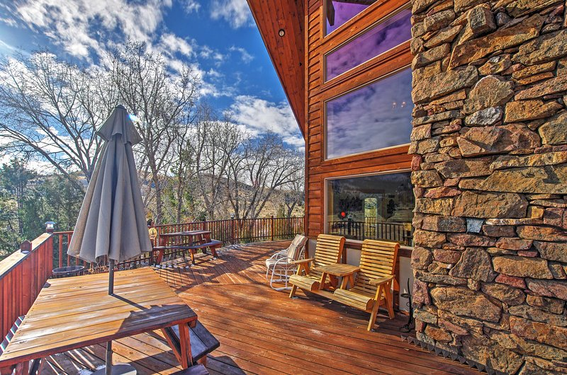 The wrap-around deck is the prime spot to view the panoramic mountain views.