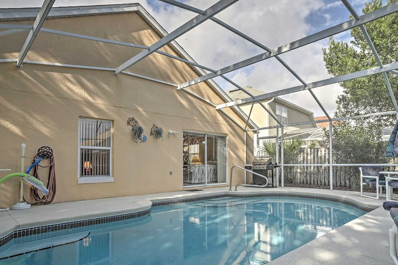 This home has a covered pool in the backyard perfect for lounging.