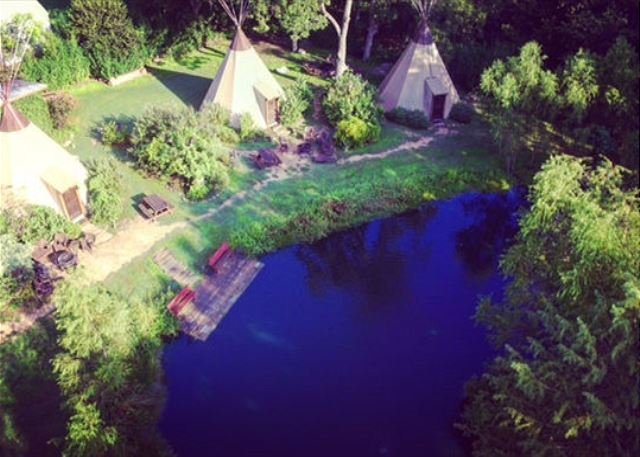Teepees surround a spring fed pond.