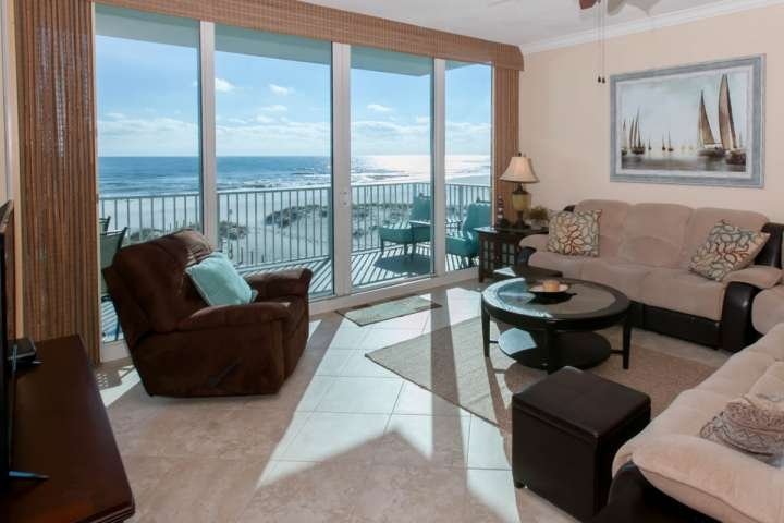 Living room with view of beach and Gulf from balcony