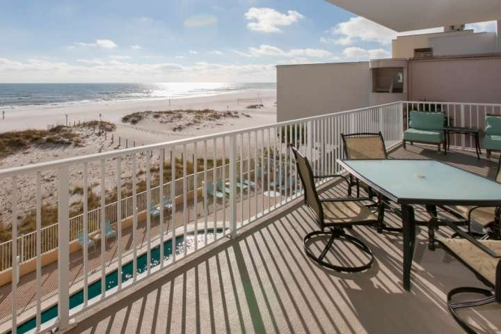 Large private balcony with seating and dining areas